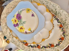 Extra large platters, egg plates and the blue plates each have a different flower pattern