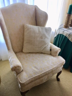 Two matching upholstered wing back side chairs